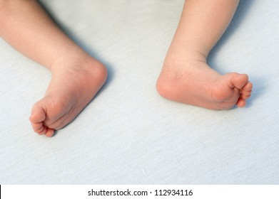 Legs of the newly born boy