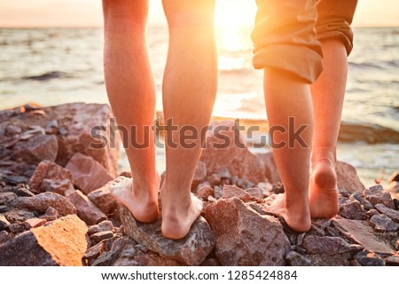 d35b01bcc ... Stock Photo (Edit Now) 1285424884 - Shutterstock. Legs on beach. Foot  spa. A young loving couple hugging and kissing on the