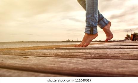 legs on the sandy beach