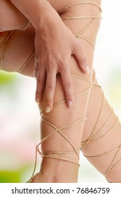 Legs pain concept - legs tied with rope