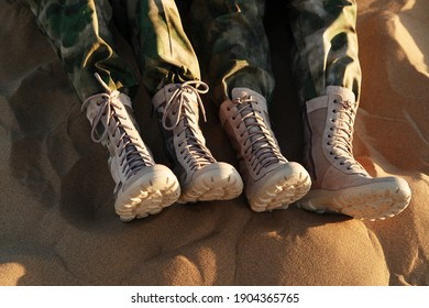 Legs of people in beige boots and khaki clothes. Caucasus, Russia