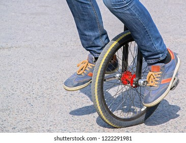 Legs of person on self-balancing electric unicycle