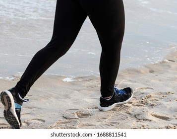 Legs of a runner running on the beach wearing spandex during the New York State Summer Series.