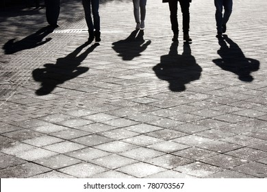 https://image.shutterstock.com/image-photo/legs-shadow-five-young-person-260nw-780703567.jpg