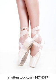 Legs in shoes of woman who dancing in ballet
