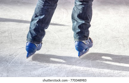 legs of a skater on ice