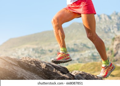 Legs of skyrunner woman with muscles and veins in action.