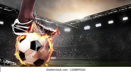 legs of soccer or football player at stadium with flame ball