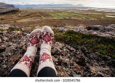 Legs in socks with beautiful ornament , on the Iceland nature and moss
