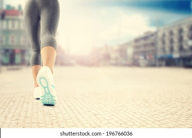 legs with sport shoes and town