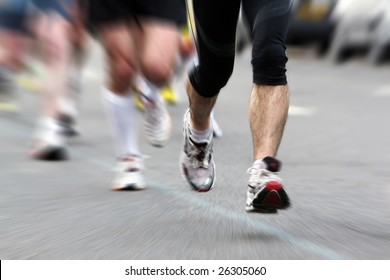 Legs of sportsmen running marathon in action, motion blur