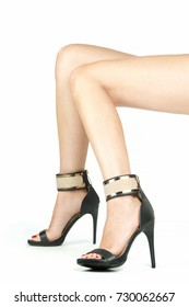 Legs with stiletto high heels shoes
