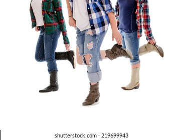 Legs of Three Women in Line Dance Class