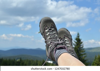 Legs in tracking shoes on a mountain high