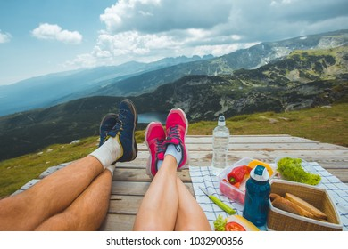 Legs of traveler couple