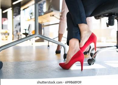 Legs of unregognizable business women in high heels.
