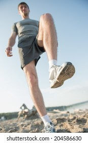 Legs View Of A Man  Jogging Outdoor on the Beach