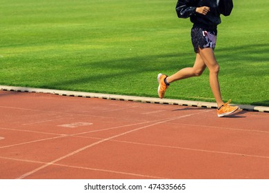 Legs View Of A man Jogging Outdoor in the Stadium