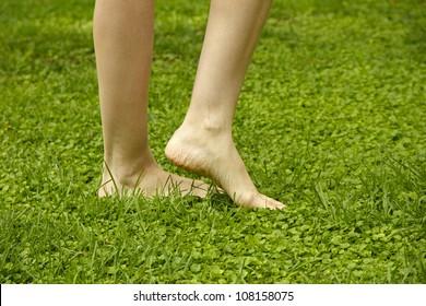 Legs walking on lawn