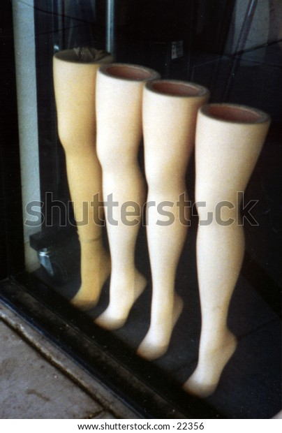 Legs in a window display photographed in a  old fashioned style with an antique camera.