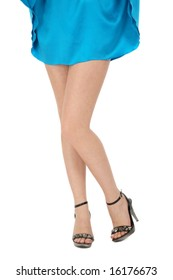 Legs of woman in bright blue mini dress and stylish stilettos