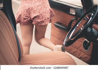 Legs of woman and old car concept abduction or kidnapping of woman and gender violence