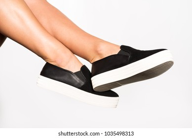 Legs of a Woman with Slip on Shoes