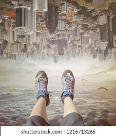 Legs of a woman  in sneakers relaxing in sky.  Invert  city upside down .Future modern business industry concept: Big city on amazing sky  at Bangkok, Thailand, Asia