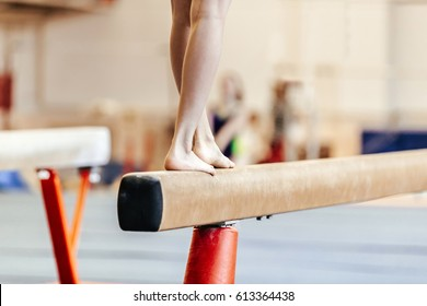 legs women gymnasts exercises on balance beam