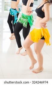 Legs of women performing traditional Arabic dance