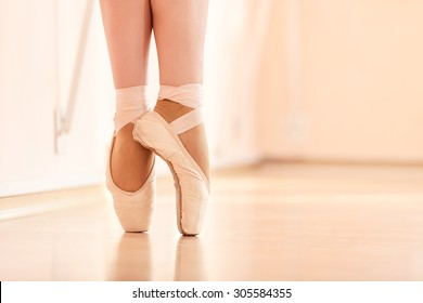 Legs of young ballerinas, ballet dancing class