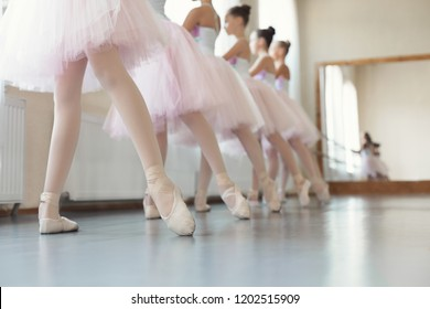 Legs of young ballerinas. Girls preparing for performance in studio, copy space