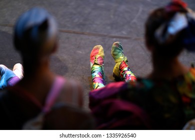 Legs of young ballet dancers backstage at the theater during intermission
