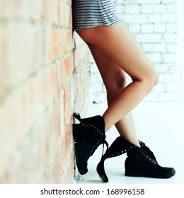 Legs of a young girl in boots