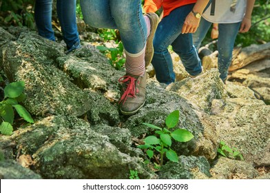 Legs of young hikers rising in mountains