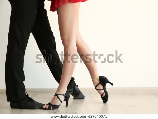 Legs of young man and woman in dance studio