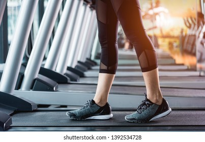 Legs young woman girl lifestyle sport running on treadmill workout exercise cardio at fitness gym