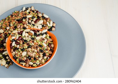 legumes in a dish on table, close up, background