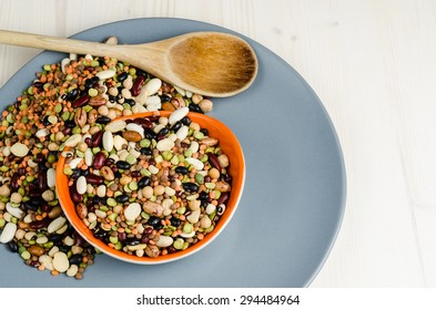 legumes in a dish on wood, close up, background