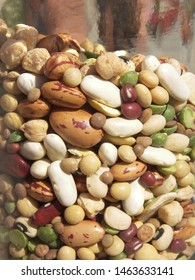 Legumes are ingredients for soups. Legumes are rich in vegetals proteins. The legumes of the photo are white, red and green.
