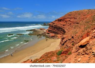Legzira beach, Sidi-Ifni, Morocco - May 06, 2017: Huge red rocky coast of Legzira beach.