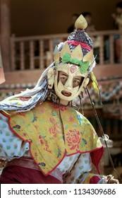 LEH DISTRICT, LADAKH REGION, INDIA - JUNE 17, 2005 : Portrait of lama (Tibetan Buddhist Monk) in Dakini sacred brass mask to honor Guru Rinpoche (Padmasambhava) the Tse-chu Festival, Hemis Monastery.