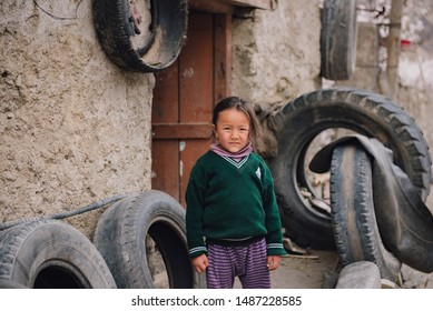 LEH, INDIA - April 14, 2019 : Portrait of unidentified tibetan girl in front of at home.