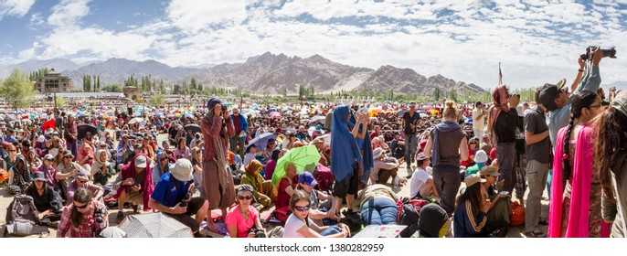 Leh, India - August 7, 2012: The crowd believers and tourists at His Holiness the 14th Dalai Lama teachings at Shewatsel Grounds in Leh, Jammu and Kashmir, Ladakh, India