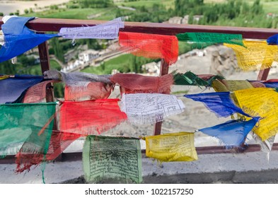 LEH, INDIA - AUGUST 8, 2017: Buddhist prayer signs in the form of multi colored flags, hangs on the rope in Himalaya, Spituk Gompa, Jamu Kasmir.