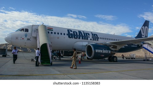 Leh, India - Jul 15, 2015. GoAir airplane docking at Kushok Bakula Rimpochee Airport. It is the highest commercial airport in India at 3,256 m.