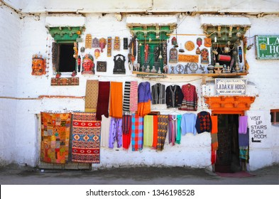 LEH, INDIA - JULY 02. Beautiful cityscape, souvenir shop with Ladakhi and hindu craft items for sale in traditional tibetan house on July 02, 2017 in Leh, Ladakh, Jammu & Kashmir, Northern India.