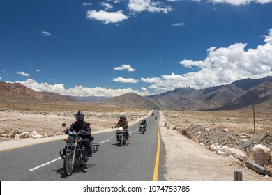 Leh, India - July 1, 2017: Group of motorbike tourists riding motorcycles on the Leh - Manali National highway in Ladakh, Northern India