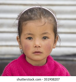 LEH, INDIA - JUNE 24, 2015: Unidentified poor Indian beggar girl on street in Ladakh. Children of the early ages are often brought to the begging profession.