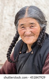 LEH, INDIA - JUNE 24, 2015: Unidentified tibetan old woman on the street in Leh, Ladakh.